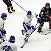 CARL RUSSO/Staff photo. Danvers' Calvin Mansfield moves the puck. North Andover defeated Danvers 5-2 in boys hockey in Division 2 North playoff quarterfinals. 3/01/2018