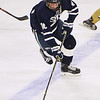 CARL RUSSO/staff photo St John's David Sacco moves the puck. St. John's Prep was defeated 1-0 by BC High in Super 8 hockey playoff action. 3/05/2018
