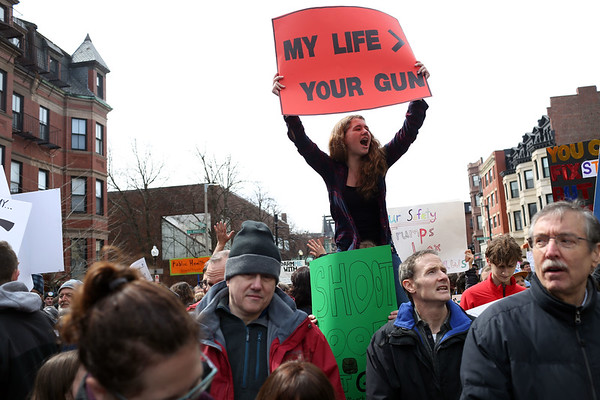 HADLEY GREEN/Staff photo<br /> A young woman chants during the March For Our Lives Boston.<br /> <br /> 03/23/18