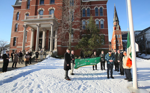 MIKE SPRINGER/Staff photo<br /> Leaders of the Ancient Order of Hibernians, Division 11, prepare to raise the tricolor Irish flag Saturday morning before the annual St. Patrick's Day breakfast Saturday at Peabody City Hall.<br /> 3/17/2018