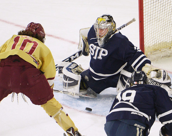 CARL RUSSO/staff photo St John's goalie, Cam Ludwig makes the save against BC's Matt Lakus. St. John's Prep was defeated 1-0 by BC High in Super 8 hockey playoff action. 3/05/2018