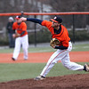 HADLEY GREEN/Staff photo<br /> Salem State's Stephen Keskinidis (10) pitches at the Salem State v. Brandeis boys baseball game at Salem State University.<br /> <br /> 03/06/18