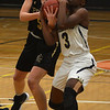 JIM VAIKNORAS/Staff photo Fenwick's Sammi Gallant ties up Archbishop Williams player Asiah Dingle at Woburn high Wednesday night.