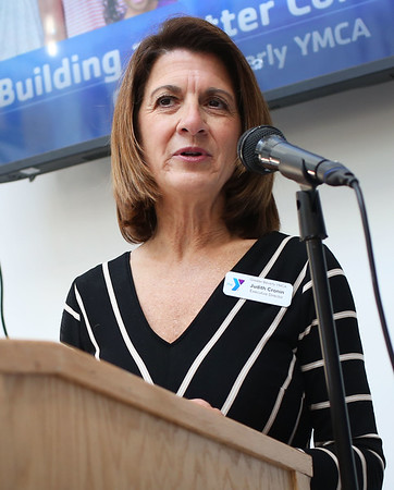 HADLEY GREEN/Staff photo<br /> Judith Cronin, executive director of the Greater Beverly YMCA, speaks at the ribbon-cutting ceremony for the new expansion at the Sterling YMCA in Beverly. <br /> <br /> 03/27/18