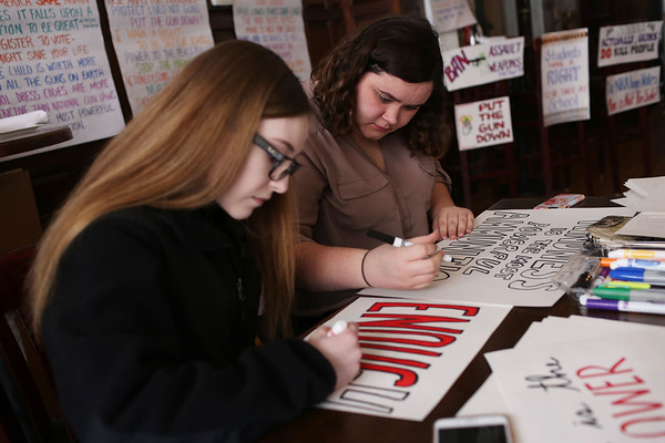 HADLEY GREEN/Staff photo<br /> From left, Melissa Bowden and Emiliee Morin make signs for the March For Our Lives event in Boston at Rockafellas in Salem before heading into the city. Congressman Seth Moulton's office helped sponsor the sign-making event and provided students with breakfast. <br /> <br /> 03/23/18