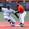 HADLEY GREEN/Staff photo<br /> Salem State's Brendan Greene (3) tags out Brandeis' Anthony Nomakeo (25) at the Salem State v. Brandeis boys baseball game at Salem State University.<br /> <br /> 03/06/18