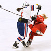 CARL RUSSO/staff photo Methuen/Tewksbury's Brenna Greene and Masco.'s captain, Kate Irons crash into each other fighting for the puck. Methuen/Tewksbury girls vs. Masconomet in Div. 1 semifinals. 3/12/2018