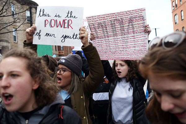 HADLEY GREEN/Staff photo<br /> From left, Beverly High School students Natalie Eberhardt, Ericka Mendonsa, Emily Zieff, and Eliza Michaels march down Columbus Ave during the March For Our Lives protest against gun violence in Boston. <br /> <br /> 03/23/18