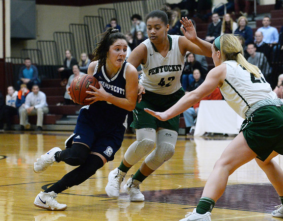 CARL RUSSO/staff photo. Swampscott's Sophie Digrande drives to the hoop against Pentucket's Arielle Cleveland and Madeline Doyle, right. Pentucket vs. Swampscott girls basketball in the Division 2 North semifinals. 3/5/2019