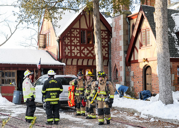 JAIME CAMPOS/Staff photo<br /> <br /> Firefighters and police officers respond to a scene of a reported fire at an Ipswich house on Thursday.<br /> <br /> 3/7/2019