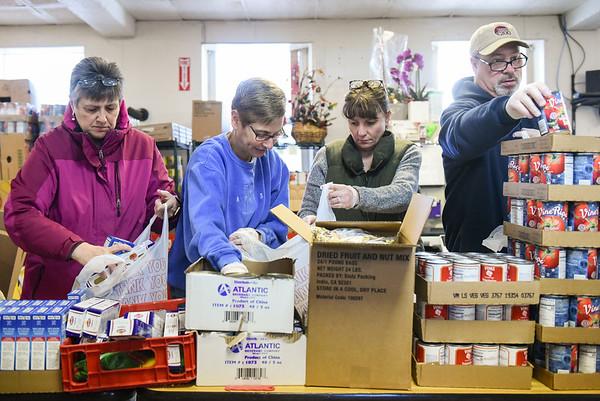 Volunteers bagging groceries for families