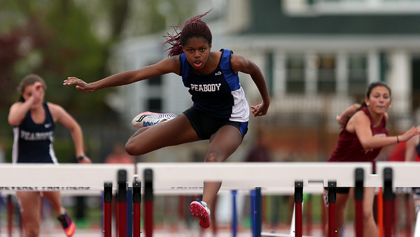 DAVID LE/Staff photo. Peabody senior Cynthia Aroke easily clears a hurdle en route to winning her heat of the 100 Meter Hurdles at the NEC Conference Meet. Aroke took home first in the finals to capture the NEC title for 2016. 5/21/16.