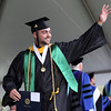 DAVID LE/Staff photo. Endicott College graduate Josh Drew waves to his friends and family after receiving his diploma on Saturday morning. 5/21/16.