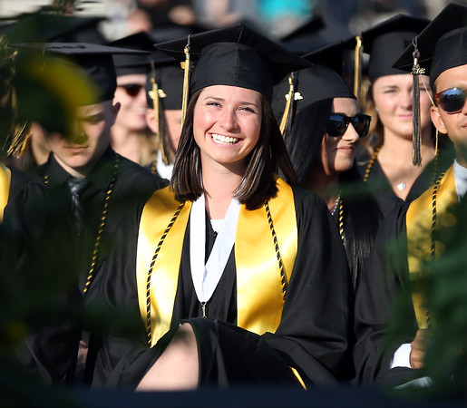 DAVID LE/Staff photo. Bishop Fenwick graduate Ellen Fantozzi flashes a wide smile while listening to Salutatorian Olivia Comeau's address at graduation on Friday evening. 5/20/16.