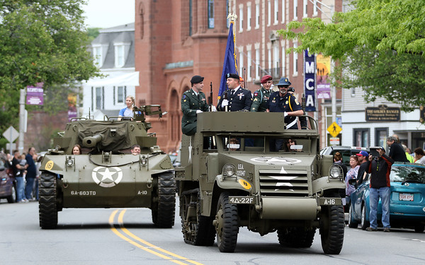 DAVID LE/Staff photo. A couple military vehicles and tanks were a big hit with the crowds lining Cabot Street during the Beverly Memorial Day Parade. 5/30/16.