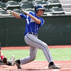 DAVID LE/Staff photo. Danvers sophomore Tommy Mento rips a RBI single against Essex Tech on Saturday afternoon. 5/14/16.