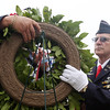 DAVID LE/Staff photo. Steve Godzik, right, helps Ron Potorski, left, place a wreath during a ceremony held at St. Mary's Cemetery in Salem on Sunday morning. 5/29/16.