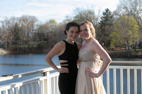 Photo/Reba Saldanha  Julia McNulty, right, and Rhianna Leslie pose for a photo at the library's Rotary Pavilion before boarding buses to the Danvers High School junior prom Friday April 29, 2016