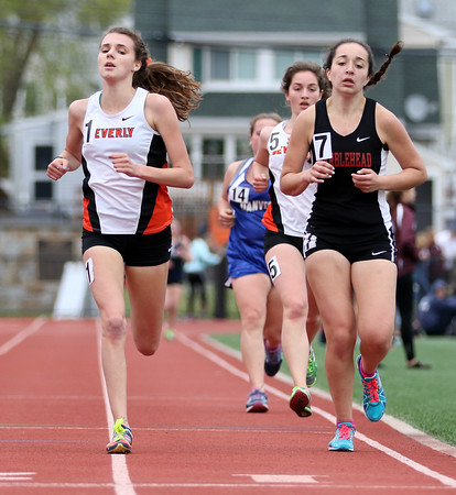 DAVID LE/Staff photo. Beverly junior Abby Walsh, left, blew away the field and lapped a few runners as she crossed the finish line to win the girls two mile NEC title in 11:12.32 on Saturday afternoon. 5/21/16.