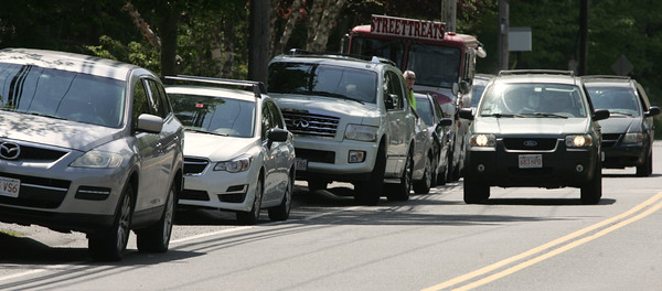 KEN YUSZKUS/Staff photo.    Cars are parked along Hull Street in Beverly to pick up students from Centerville School.      05/23/16