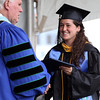 DAVID LE/Staff photo. Endicott College graduate Betsy Albiani smiles while shaking hands with Endicott College President Dr. Richard Wylie at Commencement on Saturday morning. 5/21/16.