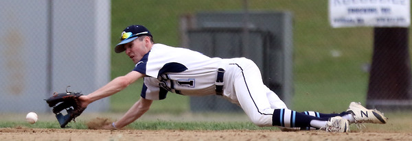DAVID LE/Staff photo. Peabody second baseman Jon Lawrence tries to make a diving play to his right but the ball took a funny bounce off the dirt and a Fenwick runner reached on an infield single. 5/30/16.