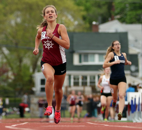 DAVID LE/Staff photo. Gloucester junior Carly Curcuru out-kicked Peabody junior Emily Christensen, right, to win the Girls Mile in 5:24.00 at the NEC Conference Meet on Saturday afternoon. 5/21/16.