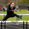 KEN YUSZKUS/Staff photo.   Ipswich's  Audrey McMorrow  runs the hurtles at the track meet held at Ipswich High School.     05/04/16