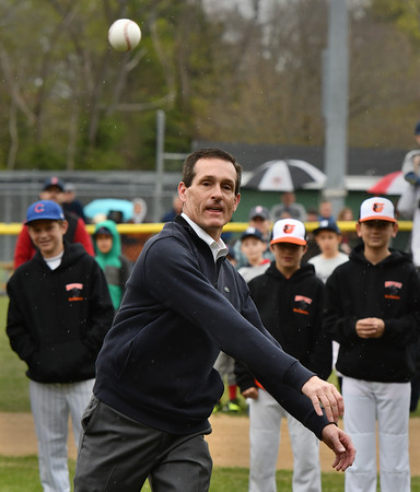 Mayor Michael P. Cahill watches his pitch head for the catcher at Beverly LL Opening Day ceremonies at Harrty Ball Field.<br /> <br /> Photo by joebrownphotos.com