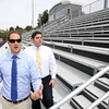 KEN YUSZKUS/Staff photo.    Danvers DPW operations director Mike Nelson, left, and Danvers public school business manager Keith Taverna speak about the new Danvers High Deering Stadium, which is where they are standing.     05/13/16