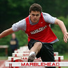 DAVID LE/Staff photo. Marblehead senior George Goetz sails over a hurdle en route to a win the boys 110 meter hurdles in a meet against Gloucester on Tuesday. 5/24/16.