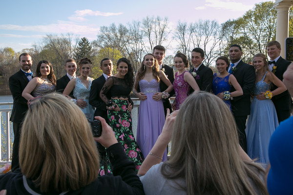 Photo/Reba Saldanha  A group poses for a photo at the library's Rotary Pavilion before boarding buses to the Danvers High School junior prom Friday April 29, 2016