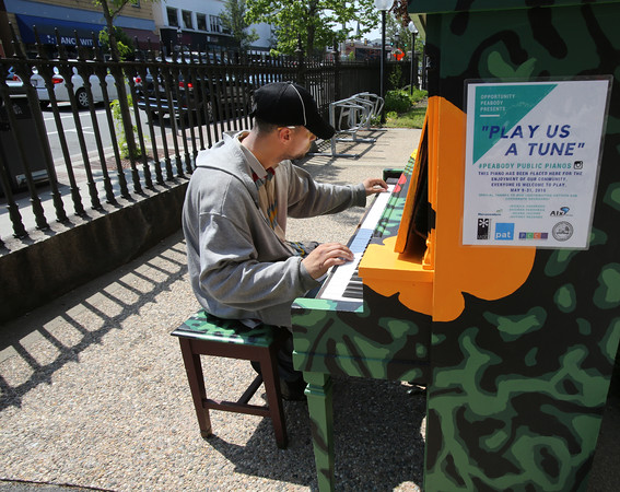 KEN YUSZKUS/Staff photo.   Hector Ferrer of Beverly plays the piano outside the Peabody Institute Library on Main Street in Peabody.       05/25/16