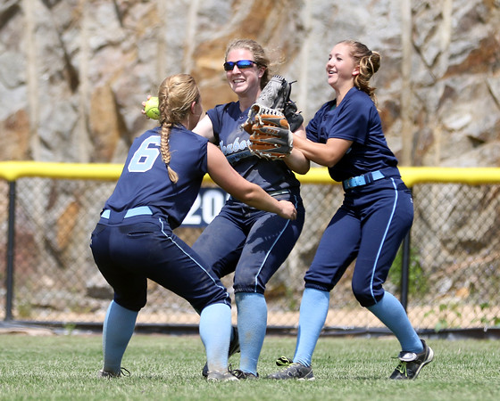 DAVID LE/Staff photo. Peabody junior center fielder Lexi Zammer, center gets mobbed by senior Ashley Jenkins (6) and sophomore Mallory Leblanc, right, after she caught the final out of their game against Bishop Fenwick. 5/29/16.