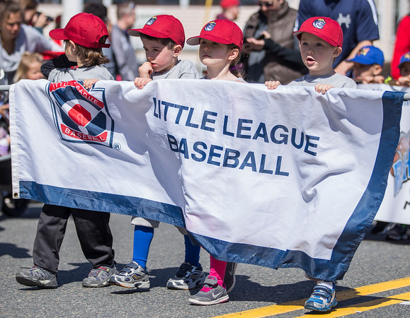 PARKER FISH/ Photo. Members of the Danvers Little League march down Maple Street in the opening day parade. 4/30/16