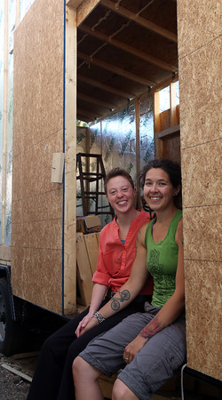 """DAVID LE/Staff photo. Partners Lindsay MacLean, left, and Courtney McLeod, of Salem, are building a """"Little House"""" that they will be shipping across the world to Hawaii. McLeod got a job on a cacao farm and the pair will be moving this little house to the farm to live. 5/11/16."""