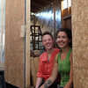 "DAVID LE/Staff photo. Partners Lindsay MacLean, left, and Courtney McLeod, of Salem, are building a ""Little House"" that they will be shipping across the world to Hawaii. McLeod got a job on a cacao farm and the pair will be moving this little house to the farm to live. 5/11/16."