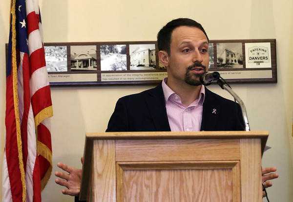 DAVID LE/Staff photo. Danvers Town Manager Steve Bartha makes opening remarks during the annual Memorial Day festivities held at Town Hall due to rain on Monday morning. 5/30/16.