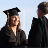 DAVID LE/Staff photo. Marblehead resident and 2016 Bishop Fenwick graduate Paige Vigneron shakes hands with Br. Thomas Zoppo, Principal of Bishop Fenwick High School, while receiving her diploma on Friday evening. 5/20/16.