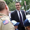DAVID LE/Staff photo. Beverly Mayor Mike Cahill talks with a boy scout troop prior to the start of the annual Memorial Day parade in Beverly. 5/30/16.