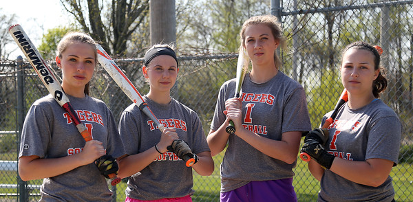 DAVID LE/Staff photo. Ipswich senior captains, catcher Skylar Hambley, second baseman Gabby D'Agostino, first baseman Abbey Sadoway, and third baseman Carly Coughlin, have led the Tigers squad to a 6-4 record in 2016 after only recording one win over the past two season. 5/12/16.