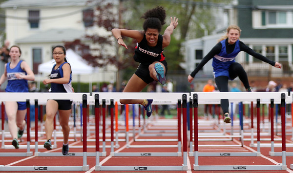DAVID LE/Staff photo. Salem senior Yailen Almonte wins her heat of the 100 meter hurdles in the preliminary round. 5/21/16.