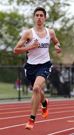 DAVID LE/Staff photo. Peabody junior Marcelo Rocha cruises to a win in the boys two mile at the NEC Conference Meet on Saturday afternoon. 5/21/16.
