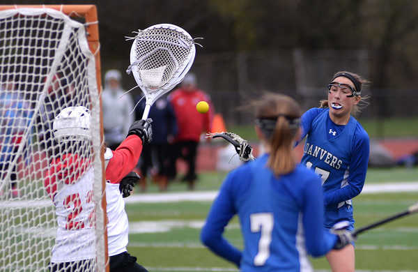 RYAN HUTTON/ Staff photo<br /> Danvers' Abby Armstrong, right, fires a shot at Salem goal tender Sydney Rocheville to score the team's fifth goal during the first half of Tuesday's game at Salem High.