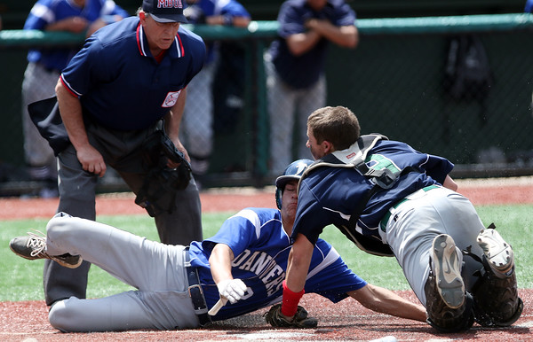 DAVID LE/Staff photo. Danvers sophomore Tommy Mento gets tagged out at home plate by lunging Essex Tech catcher Matt O'Connell. 5/14/16.