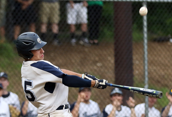 DAVID LE/Staff photo. Peabody junior Chris Gillen lifts a sacrifice fly to drive in sophomore Jake Gustin from third during the first inning of play against Bishop Fenwick. 5/30/16.