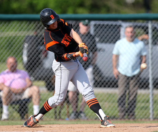 DAVID LE/Staff photo. Beverly senior captain Sean Hanlon lines a base hit against Danvers on Friday afternoon. 5/27/16.