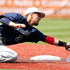 DAVID LE/Staff photo. Essex Tech shortstop Jackson Leete lunges to tag Danvers senior Andrew Olszak as he slides headfirst into second base on a steal. 5/14/16.