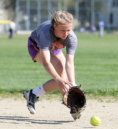 DAVID LE/Staff photo. Ipswich junior shortstop McKinley Karpa fields a grounder at practice on Thursday afternoon. 5/12/16.
