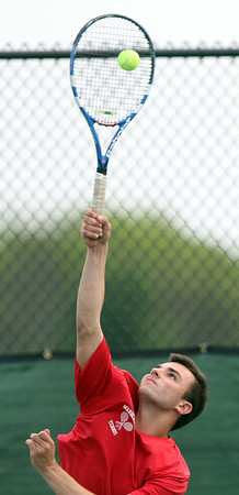 DAVID LE/Staff photo. Marblehead first singles player Justin Faia serves against Beverly on Thursday afternoon. 5/26/16.
